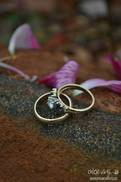 Woman's gold wedding band with diamond and sapphire engagement ring