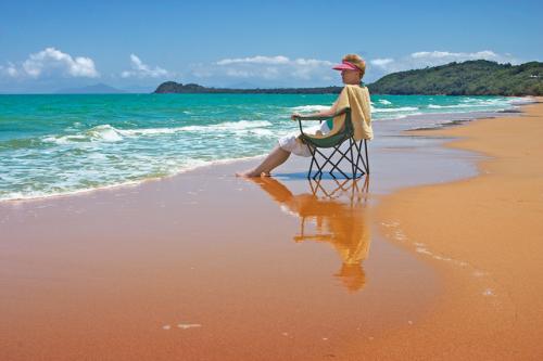 woman sitting in a beach chair on the beach