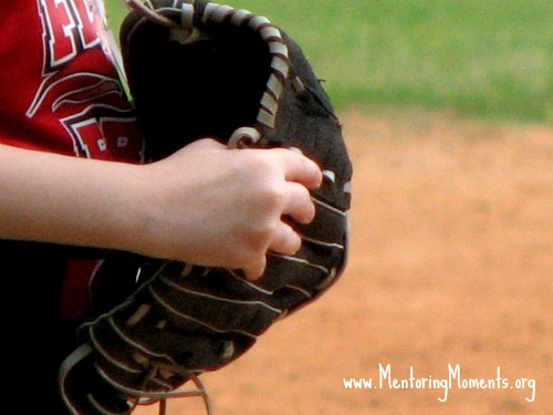 Youth holding baseball mitt.