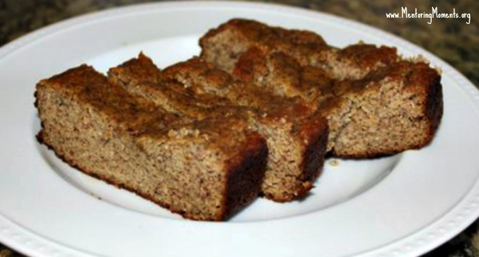 Slices of banana bread on a white plate.