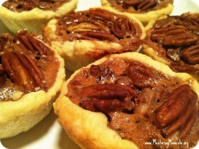 Mini chocolate pecan pies.