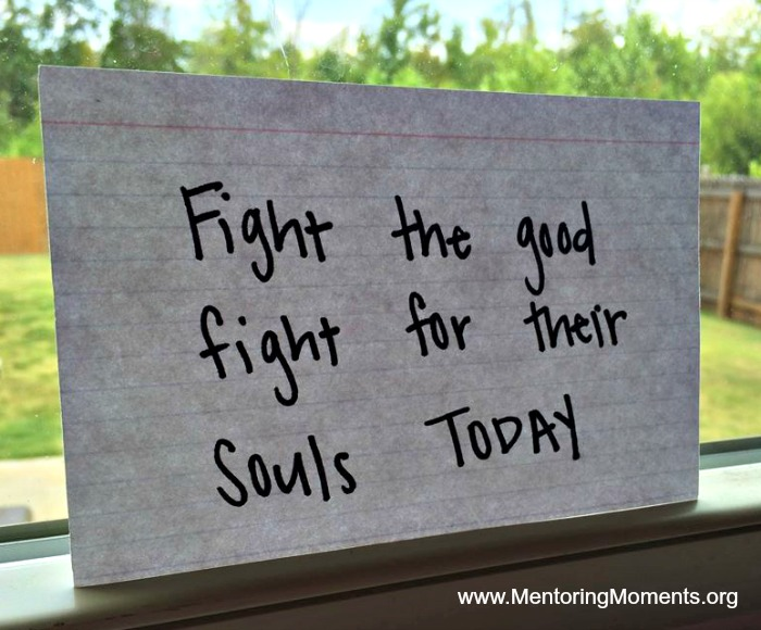 """index card in window ceil with """"Fight the good fight for their souls today"""" written on it."""